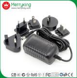 8V4a AC / DC adaptador de corriente con nosotros intercambiable Au UK EU Jp Cn plugs