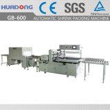 Machine automatique d'emballage en papier rétrécissable de panneaux de plancher