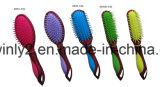 다채로운 방석 머리 브러쉬를 가진 새로운 손잡이