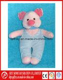 Peluche reposant le jouet rose mou de porc avec la barboteuse