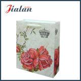 Personnaliser avec le sac de papier de cadeau de main d'achats de mode de Rose de scintillement