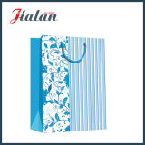 Pistes stratifiées lustrées de papier enduit et sac de papier de achat de cadeau de fleurs