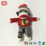 Le cadeau tricoté de peluche bourré par coton 100% badine le jouet mou de singe