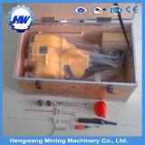 Perforatrice da roccia verticale di estrazione mineraria della benzina tenuta in mano della benzina