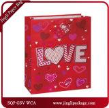 Le rayonnement du cadeau de coeur de clinquant met en sac des sacs de cadeau de transporteur de sacs de cadeau de Valentine pour Valentine