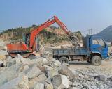 Excavador hidráulico de la rueda con la fractura del martillo