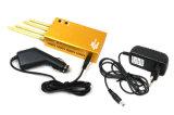 Emittente di disturbo dorata tenuta in mano del segnale di WiFi GPS del telefono mobile di colore 2g