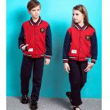 Modèles primaires faits sur commande d'uniforme scolaire pour des trainings d'école