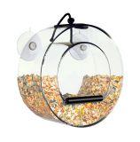 Gozar del alimentador de acrílico de los pájaros de la ventana de la vida con el lechón y la bandeja