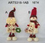 De pie Navidad Santa y muñeco de nieve de regalo, regalos sosteniendo