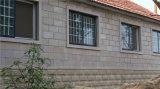 L'arenaria gialla del Teakwood copre di tegoli la decorazione naturale della pietra della parete dell'impiallacciatura