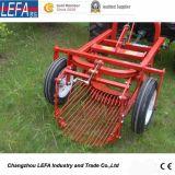 트랙터에 의하여 거치되는 당근 감자 가을걷이 기계 (AP90)
