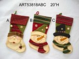 Bas de bonhomme de neige de Santa avec la décoration tricotée de Manchette-Noël