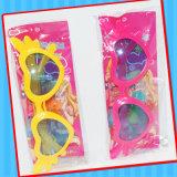 Kind-Plastikglasspielzeug mit Süßigkeit Belüftung-Beutel
