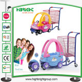 Le centre commercial badine le chariot avec le véhicule de jouet d'enfants