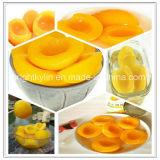 Законсервированный желтый торт babyfood половин персика