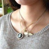 中心の鳥ヘッドが付いている多層チェーンチョークバルブのネックレスの真珠の宝石類