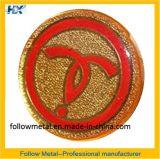 O emblema com ouro chapeou 15