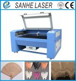 Máquina grabada corte del laser del no metal del CO2 de la fuente 100W para el cuero, paño, de acrílico