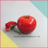 円形のモモの形の装飾的なクリーム色の瓶の贅沢で多彩なフルーツの形の包装