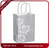 Les sacs en papier élégants argentés d'achats de sac de papier d'emballage de clients ont réutilisé des sacs de cadeau