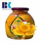 Bottiglie di vetro, pesca gialla inscatolata in sciroppo