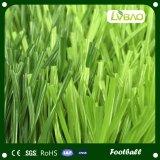 La hierba artificial para el fútbol, hierba para el balompié, se divierte la hierba