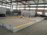 Volet de camion automatisé pour usines de béton mixtes