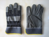 暗い色の家具の革やしデニムの背部ドライバー手袋