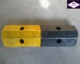 黄色および黒いゴム製車輪ストッパー