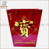 리본 손잡이를 가진 물색 종이 봉지 또는 선물 종이 봉지 또는 종이 쇼핑 백