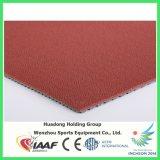 Il materiale arrotolato di gomma mette in mostra la stuoia del pavimento
