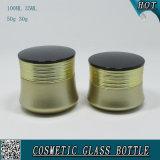 Tarro poner crema cosmético coloreado oro de la botella de cristal y del vidrio