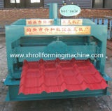 Tuile glacée par toit formant la machine