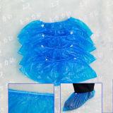 Blaues gleitsicheres Wegwerf-PET Plastikschuh-Deckel mit elastischer Oberseite herum
