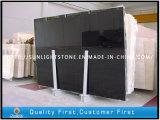China Azulejos de piso de mármol de veta de madera negro para cocina / baño decorativos