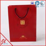 Мешок бутика верхнего качества изготовленный на заказ напечатанный логосом бумажный с голубой Nylon веревочкой