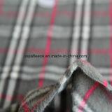 Cepillado polar tela gris con las comprobaciones de diseño
