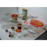 Relleno de la taza del yogur y equipo del lacre