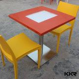 Tabela de jantar branca do restaurante de pedra artificial do fast food com a cadeira para a venda