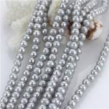 7mmは円形の自然な淡水の真珠の緩いビードの繊維を離れて灰色カラーを染めた