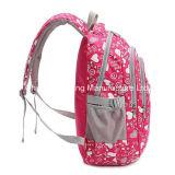 ランドセルに戻る小学校学生のピンクの女の子のバックパック
