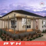 Casa prefabricada de dos pisos del chalet con el garage