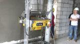 Muro de cemento de la construcción que enyesa el equipo de la maquinaria