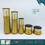 Botella de vidrio cosmético de color amarillo dorado y tarro de crema de vidrio cosmético