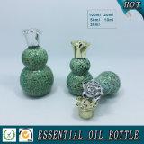 Bouteille d'huile essentielle en verre à forme double gourde avec bouchon de fleur