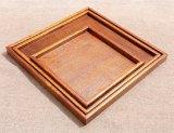 Laque enduisant les plateaux en bois