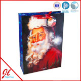 Le cadeau de papier de estampillage chaud bleu met en sac des sacs en papier d'achats de Noël