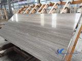磨かれた薄い灰色の木製の大理石の平板