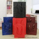 Blauer Farben-Papier-Geschenk-Beutel mit Goldgewinde